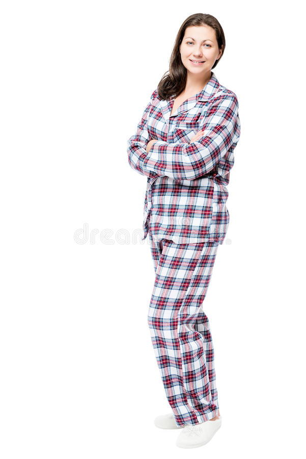 Woman in warm flannel pajamas posing in studio on white royalty free stock images