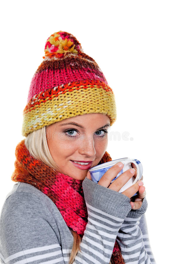 Woman with a warm hood with hot tea. Young woman with a warm hood with hot tea royalty free stock image