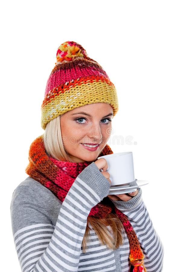 Woman with a warm hood with hot tea. Young woman with a warm hood with hot tea royalty free stock photos