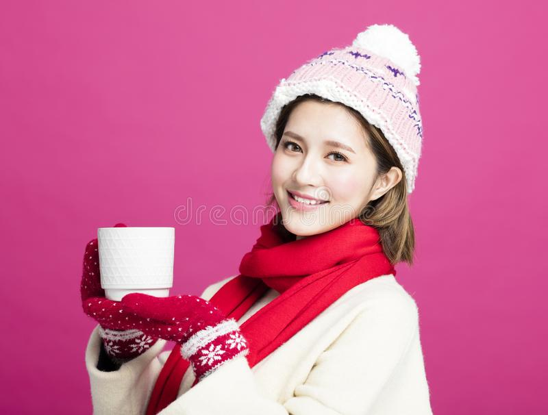 Woman in warm sweater drinking a cup of tea. Woman in warm sweater drinking a cup of hot tea royalty free stock photography