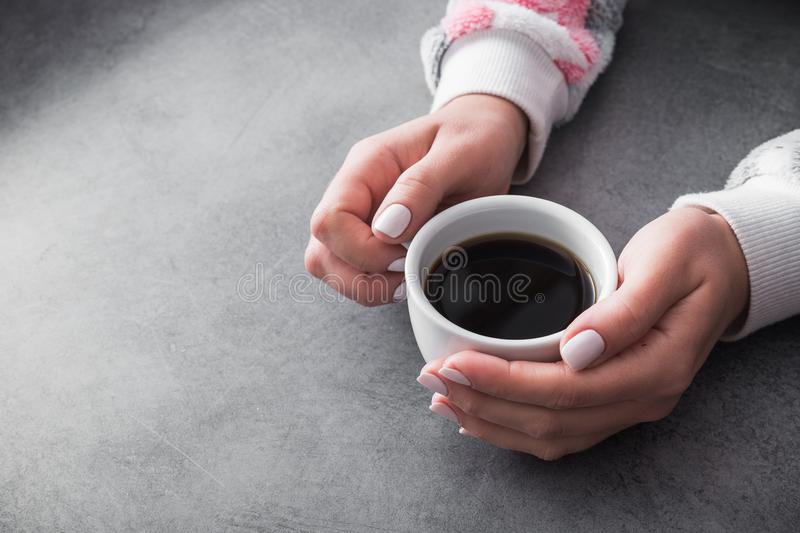 woman in warm sweater holds a white cup of coffee royalty free stock photos