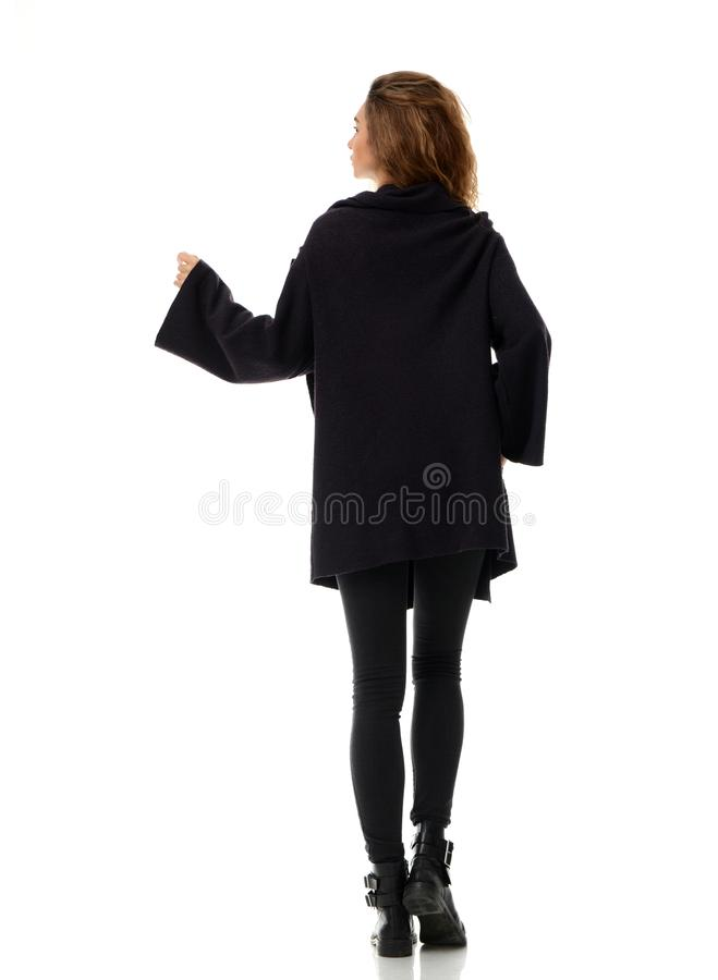 Woman in warm winter clothes jacket rear back side view royalty free stock images
