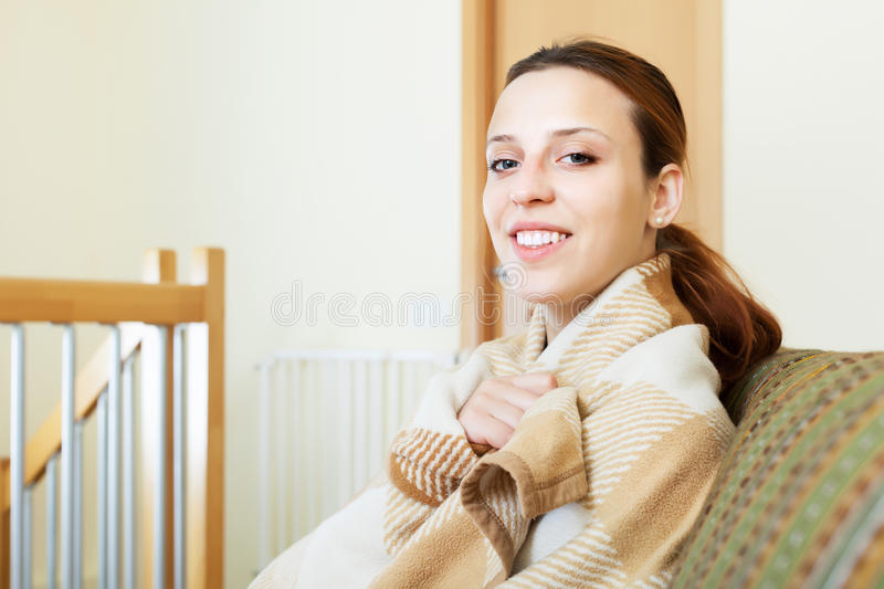 Woman Warming In Plaid Stock Image