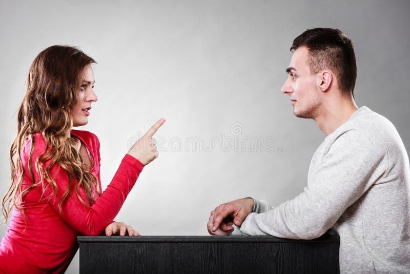 Woman warning man. Girl threatening with finger. royalty free stock photo