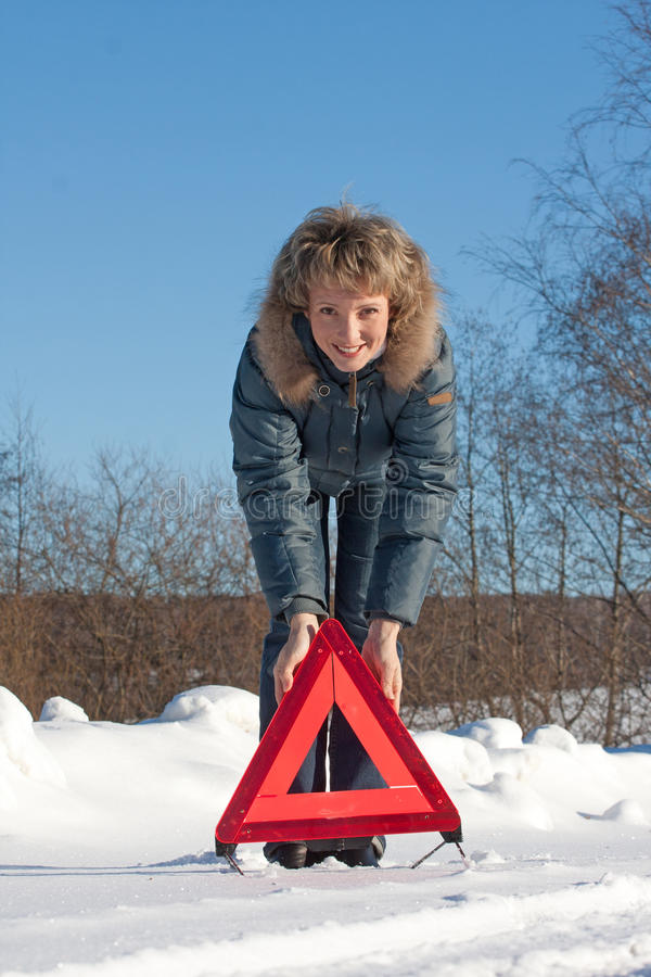 Download Woman With A Warning Triangle Stock Image - Image: 18129573