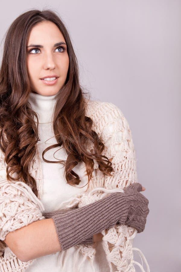 Woman warped in sweater