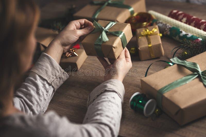 Woman packing Christmas gift stock photos