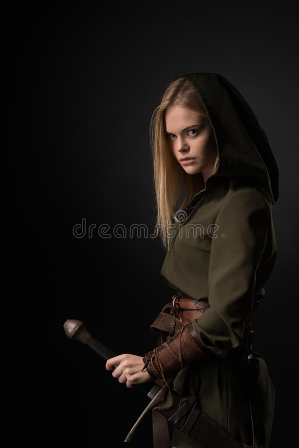 Woman warrior with sword stock image