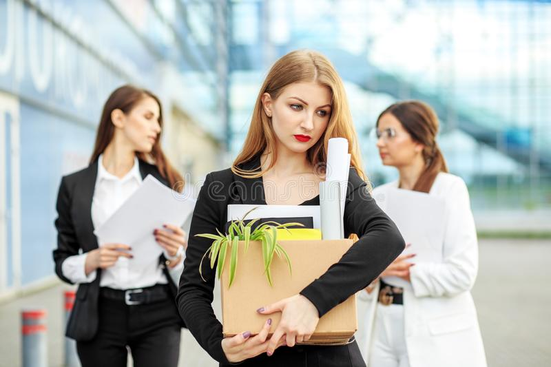 The woman was fired from the corporation. The end of a career. Concept for business, unemployment, labor exchange and dismissal royalty free stock photos