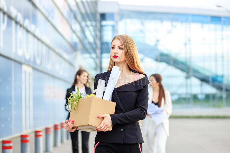 The woman was fired from her job. Concept for business, unemployment, labor exchange and dismissal. The women was fired from her job. The end of a career stock images