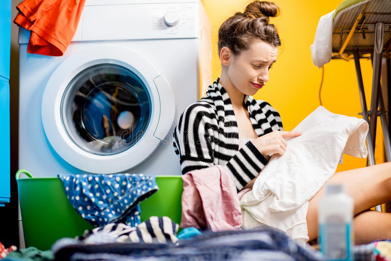 Woman washing clothes at home royalty free stock photography