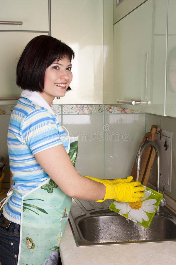 Free Woman Washing Dishes In Kitchen Stock Image - 13741061