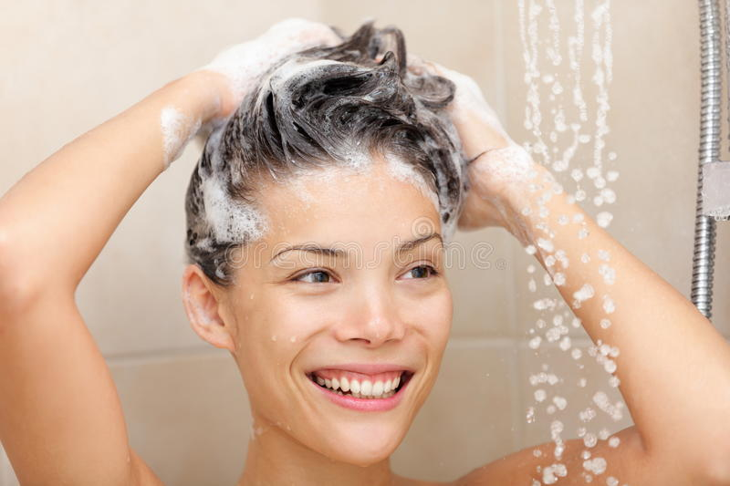 Woman washing hair stock photography
