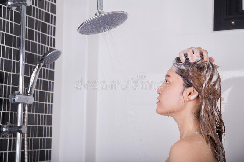 Woman washing head and hair by shampoo royalty free stock photo