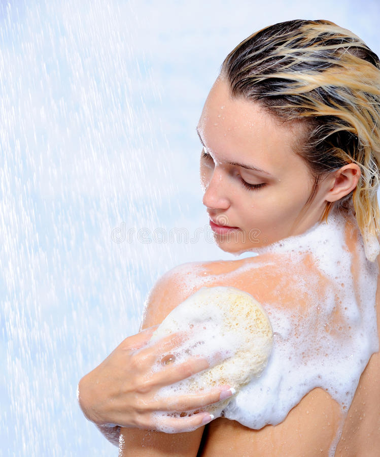 woman washing her body royalty free stock image