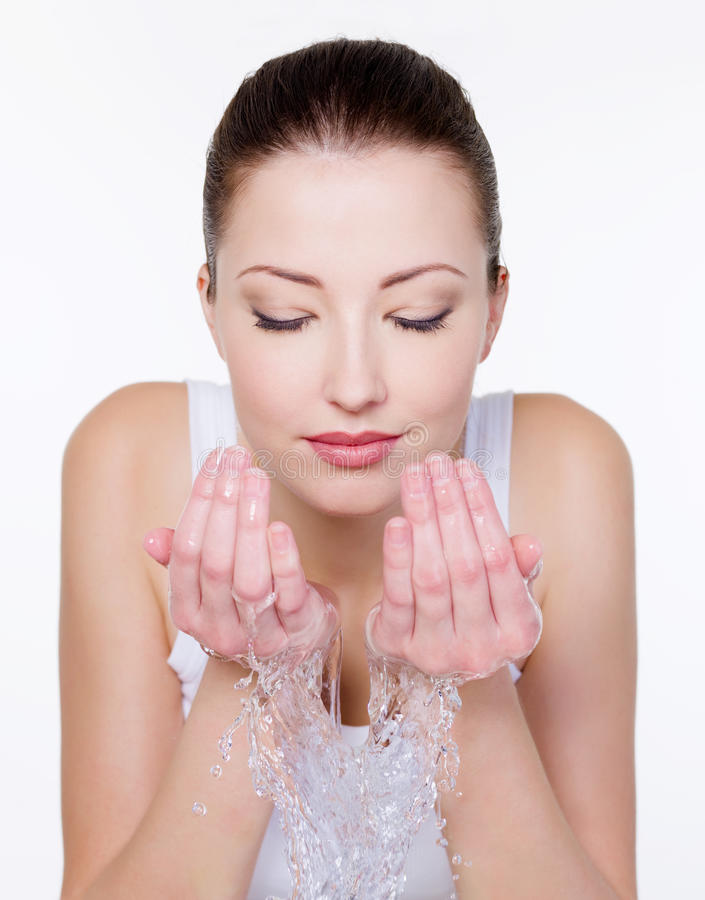 Free Woman Washing Her Face Royalty Free Stock Images - 12239349