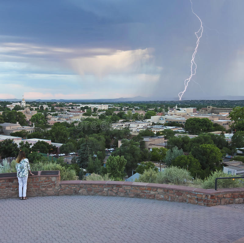A Woman Watches a Lightning Storm from Fort Marcy Park stock image