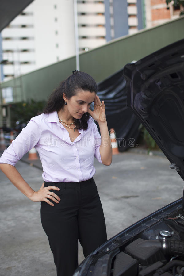 Download Woman watching car engine stock image. Image of breakdown - 22700905
