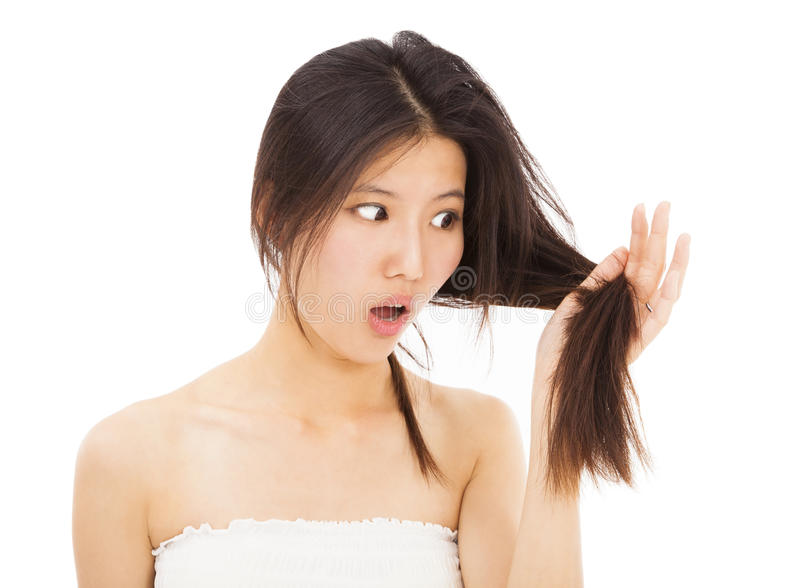 Woman watching the damage hair and splitting ends stock photos