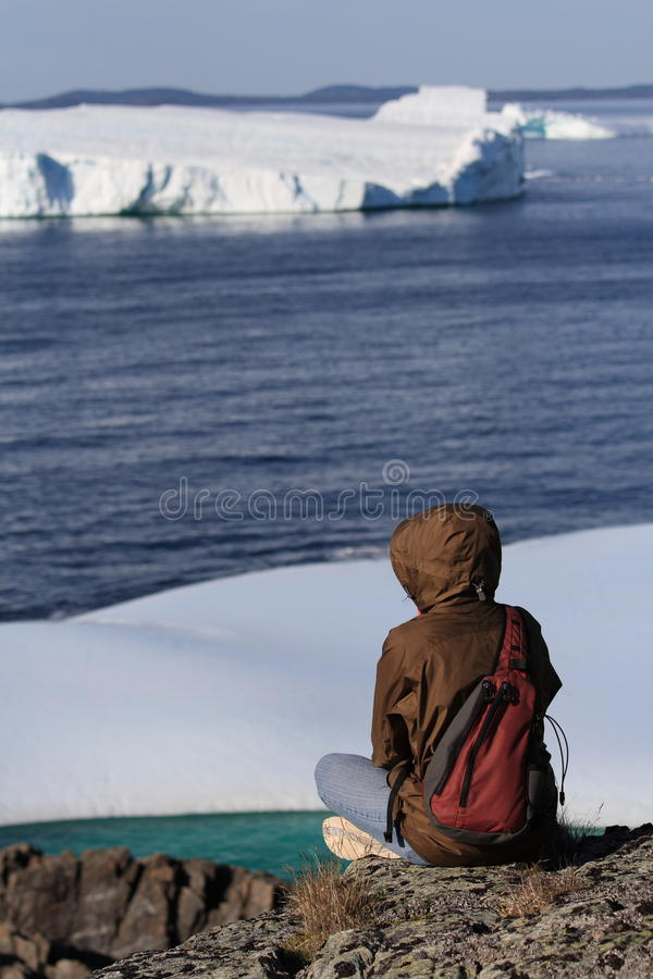 Woman Watching Icebergs from Shore stock photos