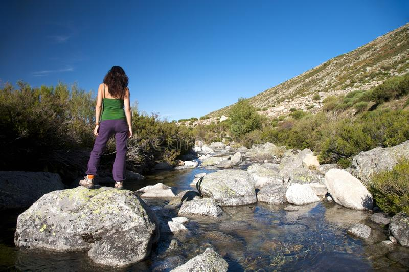 Download Woman watching river rock stock image. Image of back - 12484523