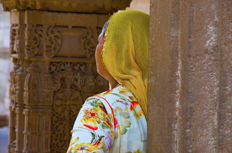 Woman watching sculptures in Adalaj Ni Vav Stepwell or Rudabai Stepwell. Ahmedabad, Gujarat, India stock photo