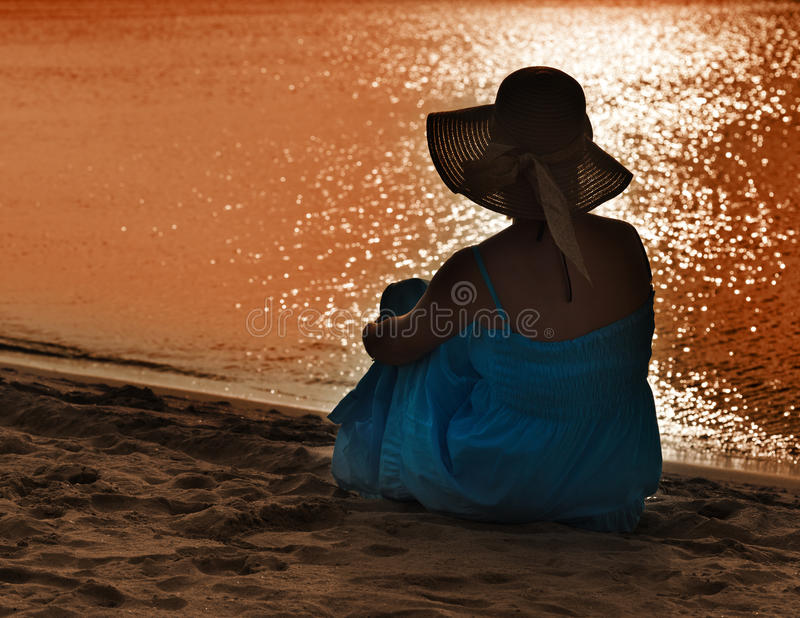 Woman watching the sea royalty free stock photos
