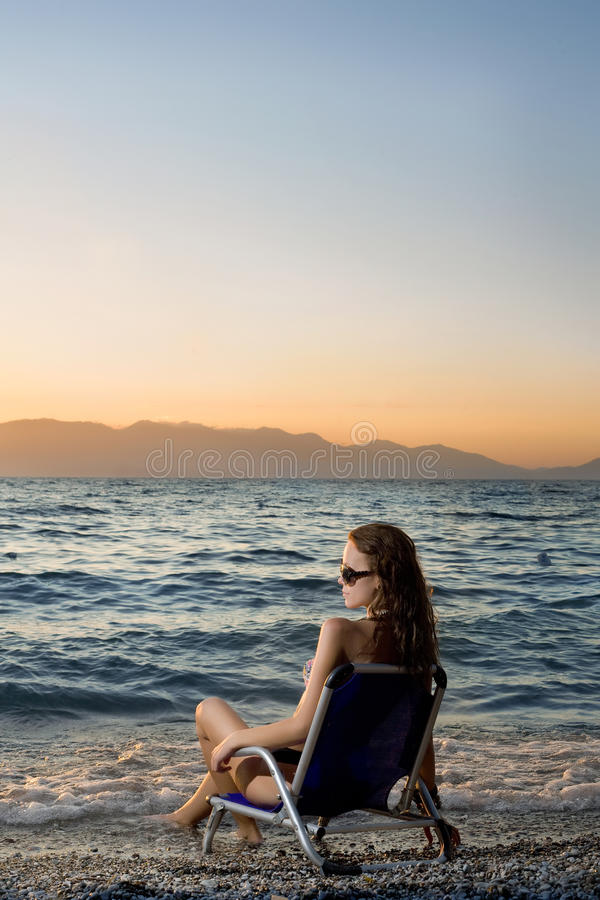 Download Woman Watching Sunset On The Beach Stock Photo - Image: 20419902