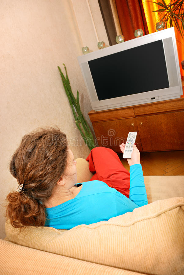 Download Woman watching tv stock image. Image of sitting, flat - 13782699