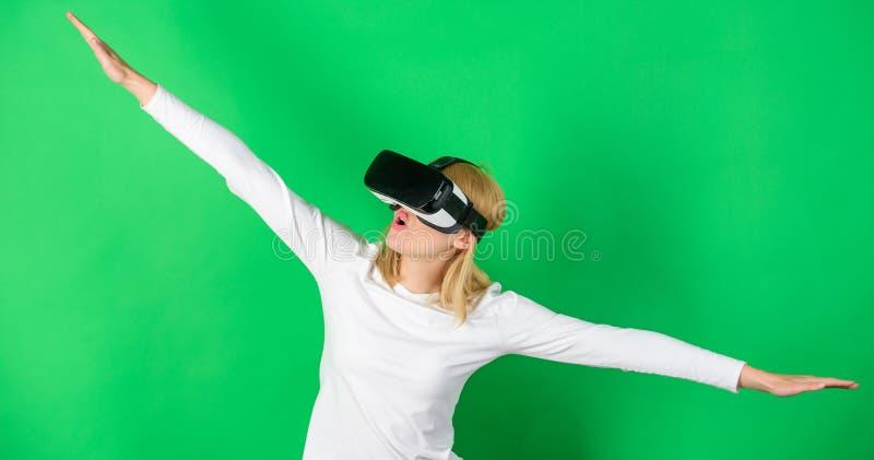 Woman watching virtual reality vision. Woman using virtual reality headset. Woman wearing virtual reality goggles. VR. Digital stock image
