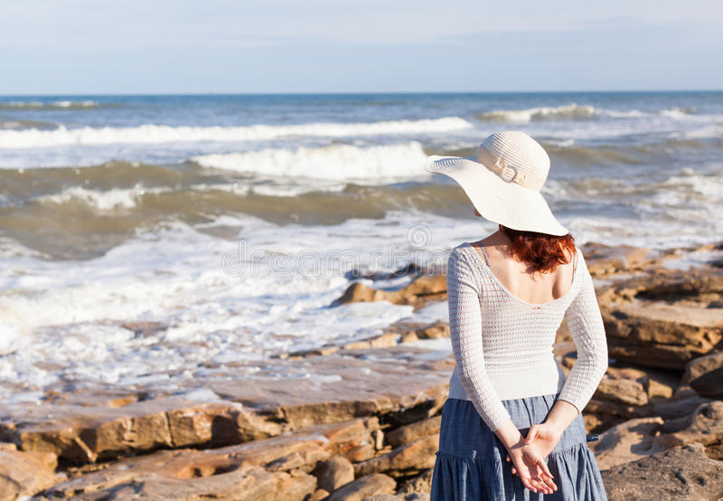 Woman watching waves royalty free stock photography