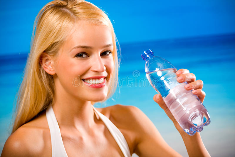 Woman with water. Woman with bottle of water stock image
