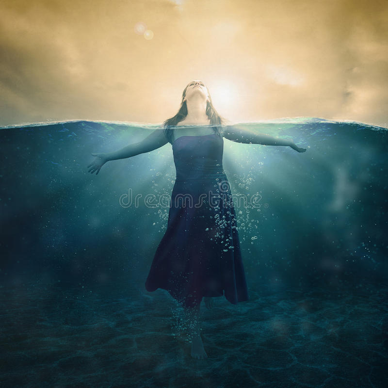 Woman in water royalty free stock photography