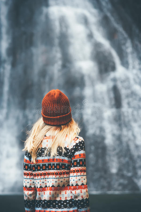 Woman and waterfall Travel Lifestyle adventure. Concept vacations into the wild stock photos