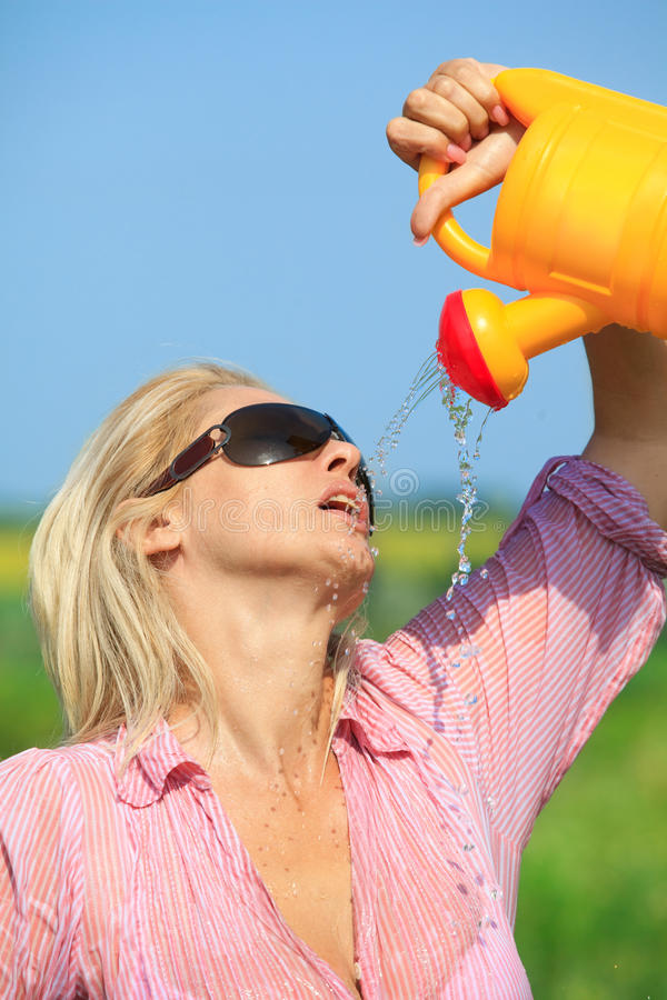 Woman Watering Herself Royalty Free Stock Photography