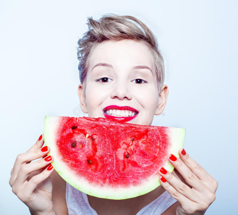 Woman and watermelon. Young beauty woman holding watermelon in her hand royalty free stock photo