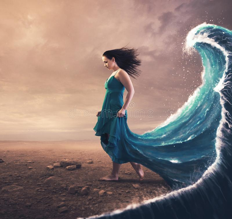 Woman and wave stock photo