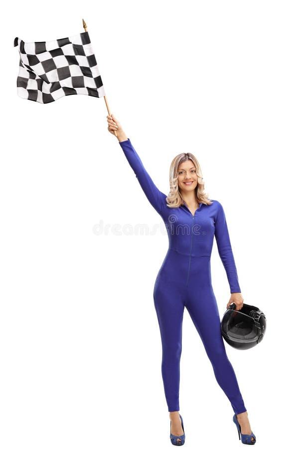 Woman waving a checkered race flag stock photos