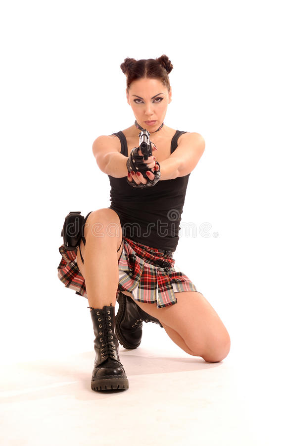 Woman with weapon. Armed woman posing with weapon, isolated on white royalty free stock photography