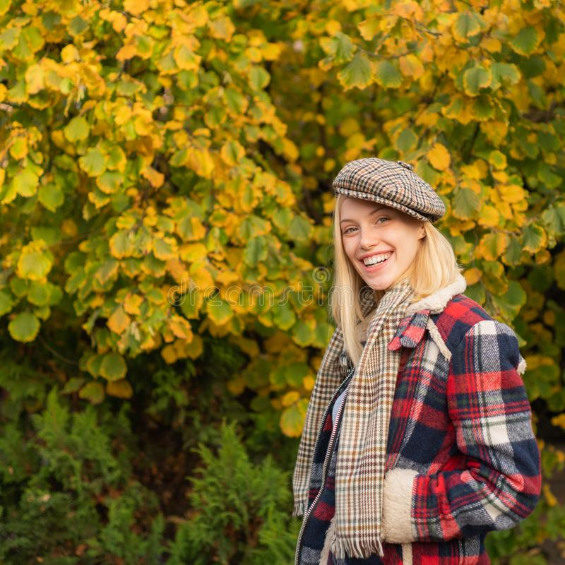 Woman wear checkered clothes nature background. Girl wear kepi. Fall fashion accessory. Adorable blonde fashion girl royalty free stock photos