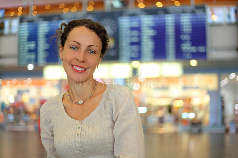 Woman in wear in hall of airport royalty free stock photo