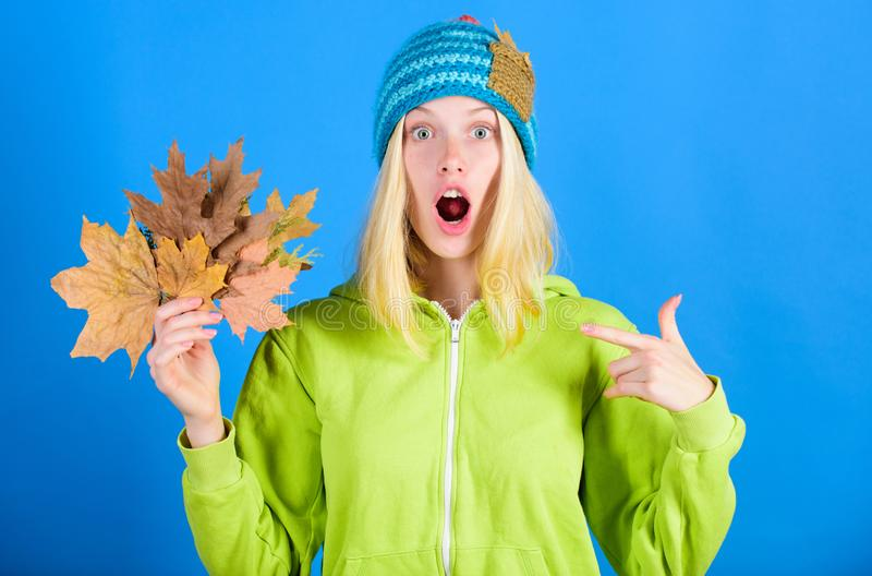 Woman wear knitted hat hold fallen leaves. Skincare and beauty tips. Skincare routine for autumn. Enjoy autumn season royalty free stock photo
