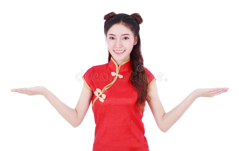 Woman wear red cheongsam with open hand palm in concept of happy stock photos