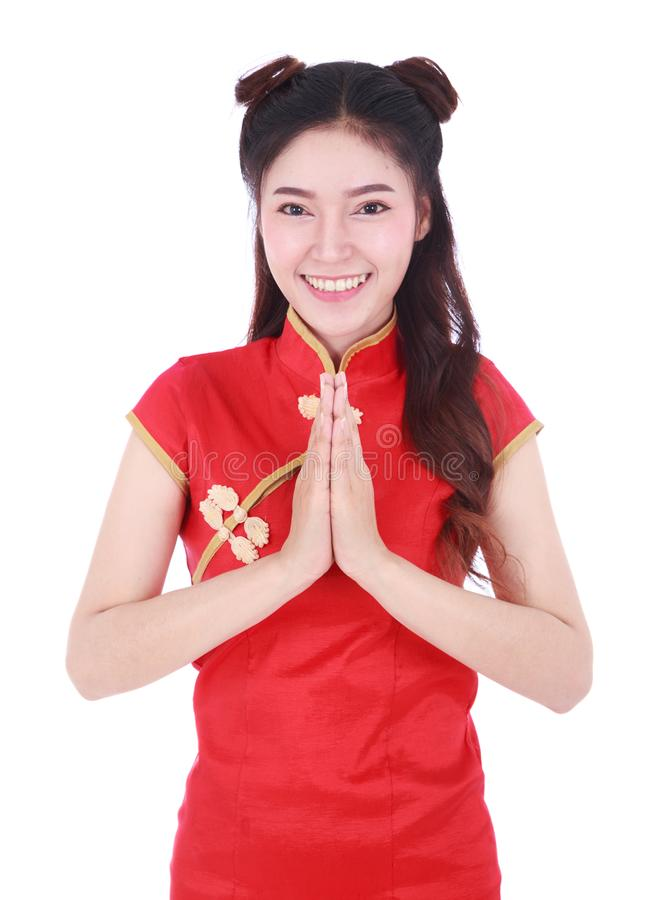 Woman wear red cheongsam and pay respect in concept of happy chi stock photography