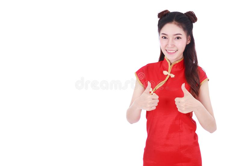 Woman wear red cheongsam and thumb up in concept of happy chines royalty free stock photo