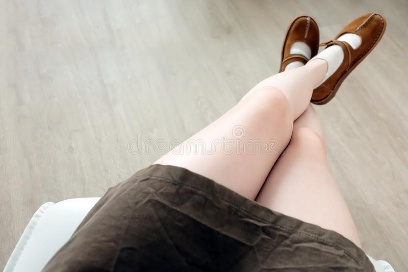 Woman Wear Shoes. Female Fashion Concept. Stylish Brown Suede Boots. Top View of Fashion Boot on the Wood royalty free stock image