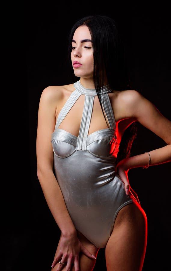 Woman wear silver bodysuit lingerie. Future time fashion model. Girl attractive body wear futuristic fashion lingerie stock photo