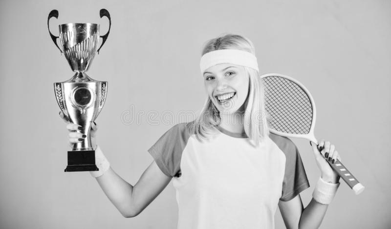 Woman wear sport outfit. Tennis player win championship. First place. Sport achievement. Celebrate victory. Tennis. Champion. Athletic girl hold tennis racket royalty free stock images