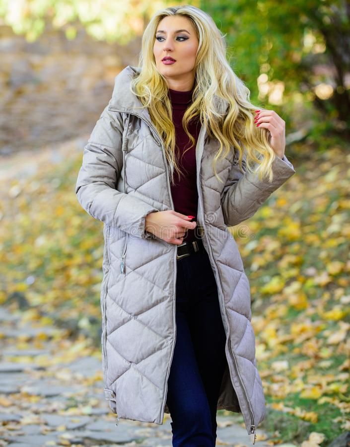 Woman wear warm grey jacket. Jacket everyone should have. Oversized jacket trend. How to rock puffer jacket like star stock images