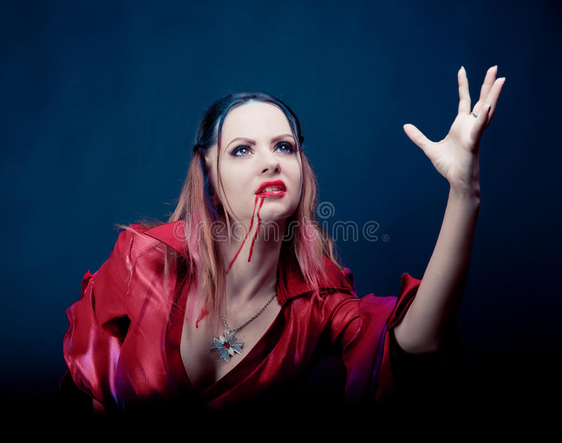 Woman wearing as vampire dancing . Halloween stock photo
